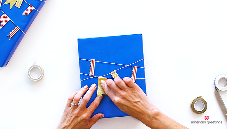 Step 7 illustrated with hands placing pennants on the twine