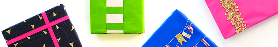 Colorful and creative gift wrapping techniques shown on 4 wrapped boxes in black, green, blue and pink.