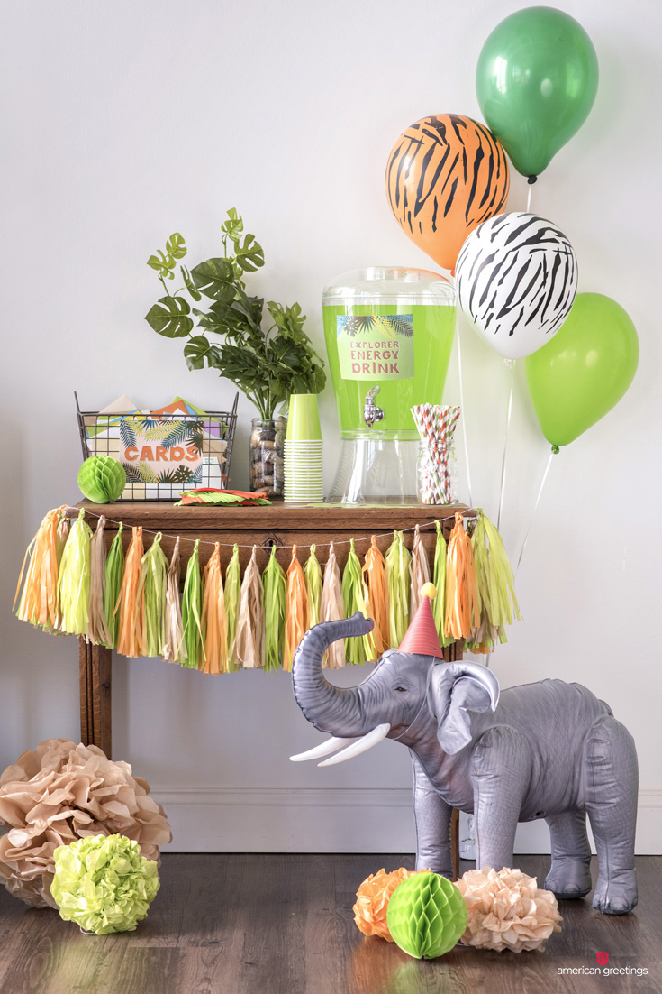 Jungle theme birthday drink table