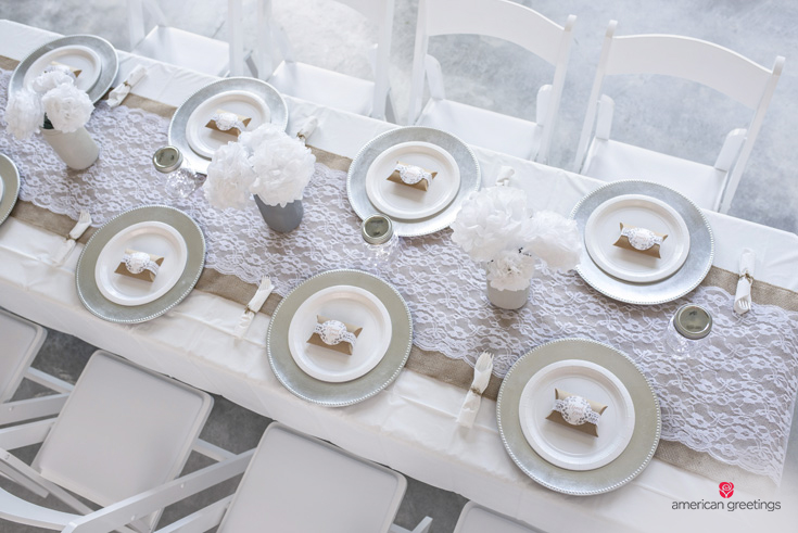 Table place setting for a white birthday party