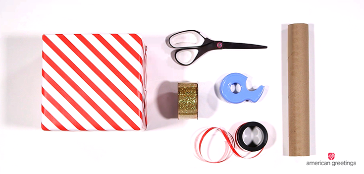 Step 1 - supplies you'll need: wire ribbon, curling ribbon, a papel towel roll, scissors, tape.