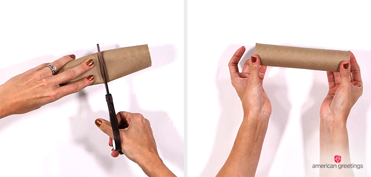 Step 2 - hands cut down the paper towel roll