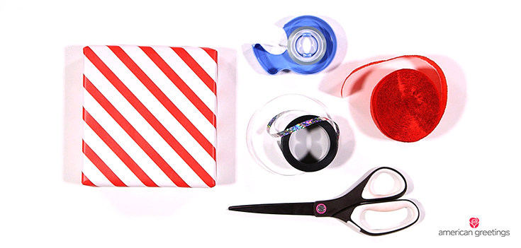 Step 1 - supplies you'll need: wrapped present, crepe paper, curling ribbon, scissors, double-sided tape