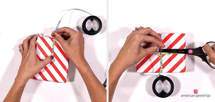 Step 2 illustrated with hands wrapping the curling ribbon around the gift and attaching it with double sided tape