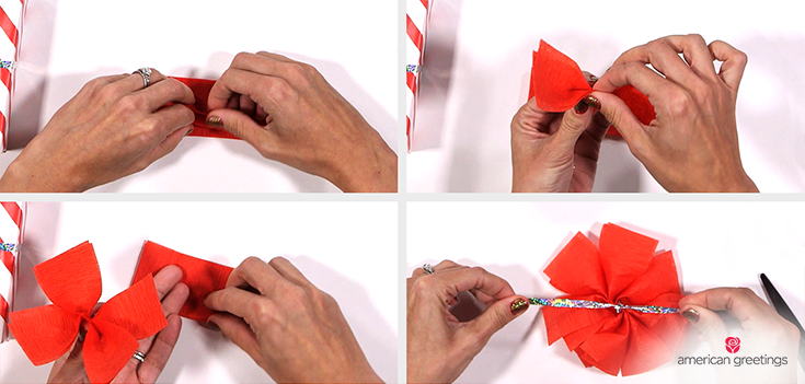 Step 5 - hands using the curling ribbon to tie a knot around the crepe paper at the pinched middle and cut off any extra ribbon