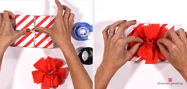 Step 6 illustrated with hands adding poinsettia to a gift by using double sided tape and then taping the flower onto the package.