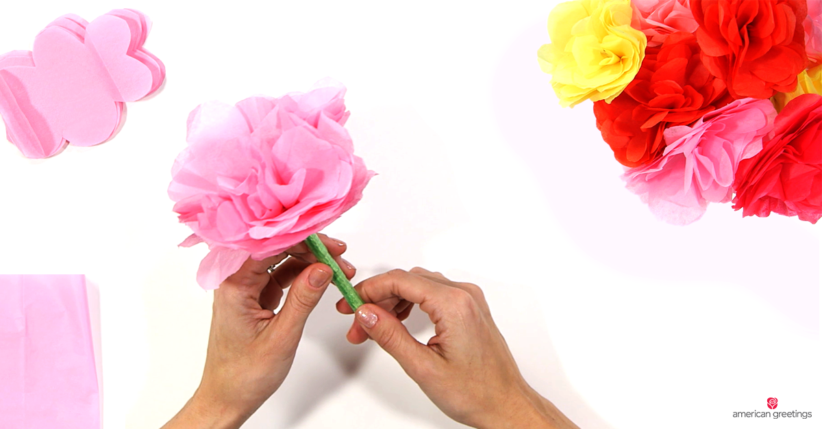 Image of handmade tissue paper flower pen and bouquet of paper flowers