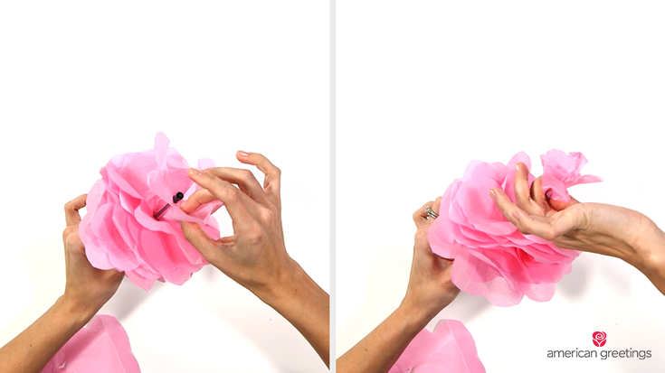 Step 5 - Holding the flower between your thumb and index finger, wrap the very base of the flower in double-sided tape
