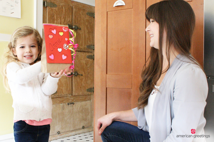 image with a little girl holding a surprise lunchbox