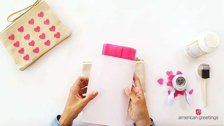 Step 1 - make the tissue paper hearts by placing the tissue paper inside a folded piece of regular paper