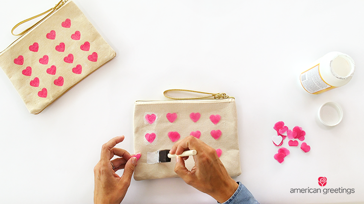 Step 4 - apply a generous amount of Mod Podge to the canvas and press your hearts on to the bag