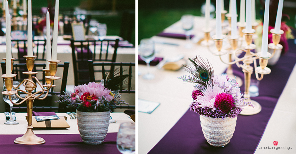 Table set with a white tablecloth, purple table runner, flower arrangements, and elegant gold candlesticks and candles.