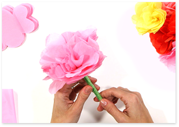 Pink tissue paper DIY flower pen with multicolored tissue paper flowers and supplies.