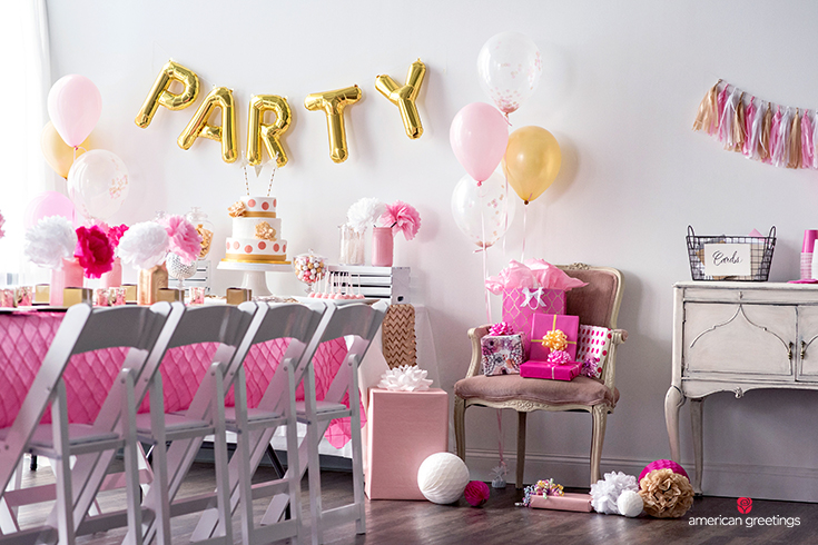 Viewing a Table Display of Pink and Gold Engagement Party