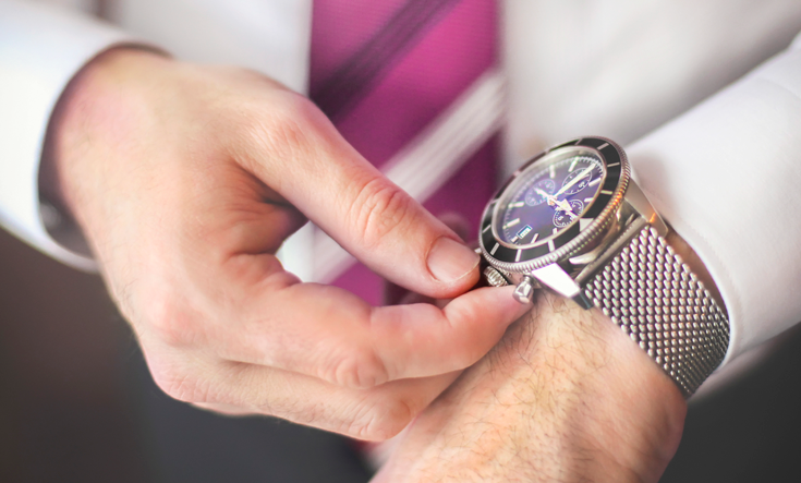 close up image with a man wearing a watch