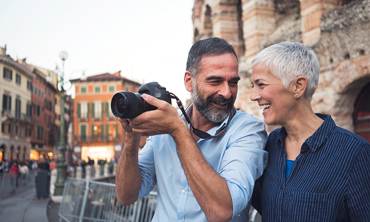 man and woman laughing and taking pictures