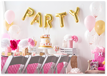 Party golden wall balloon in a pink party decor