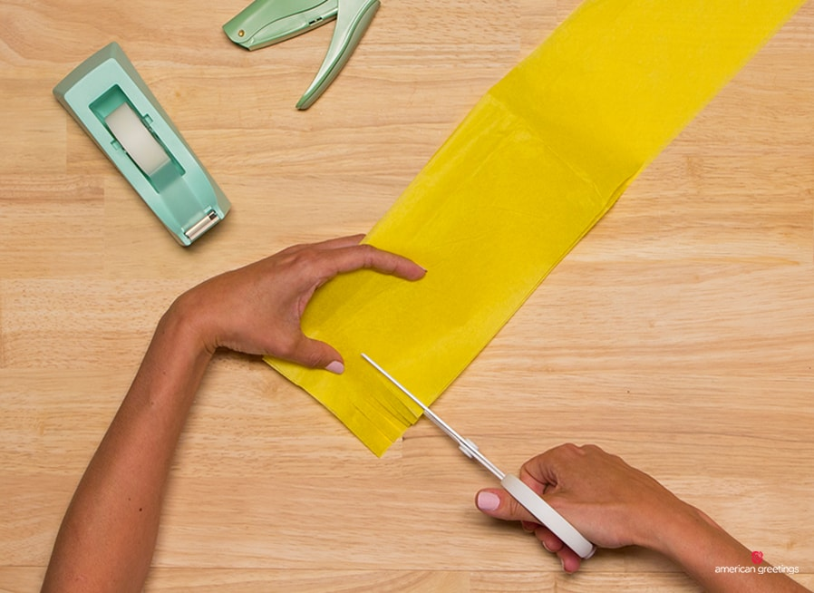 Step 2 - Snip your tissue paper strip into fringe using scissors