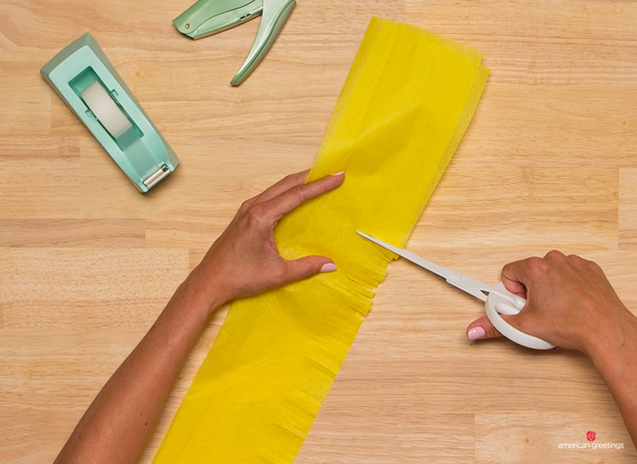 Step 3 - cut only halfway through the width of your tissue paper strip