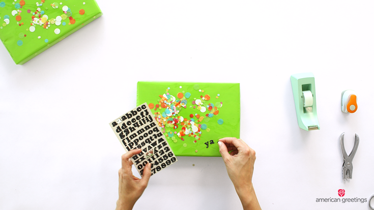 Step 8 - use letter stickers to add a fun message to your confetti gift wrap