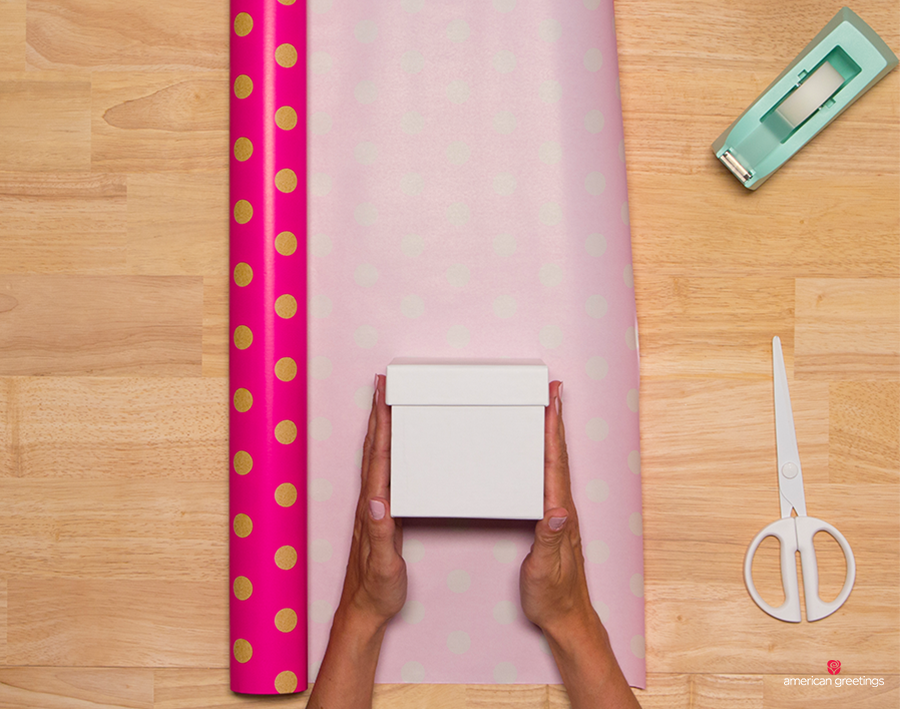Step 1 - Place the gift box on your wrap to where the edge of the paper will fit about ¾ of the way up the side of the box