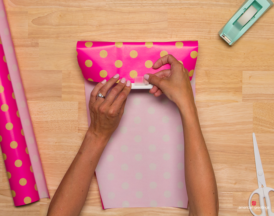 Step 6 - Take the top edge of the paper and cover about ¾ of the bottom of the gift