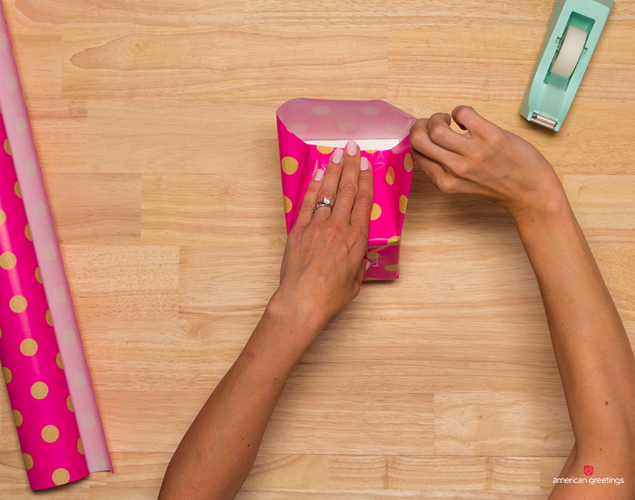 Step 9 - Fold the top flat against the box, using two fingers to press the seams on each side. Secure with tape
