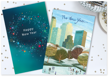 image with 2 cards one with sparkly happy new year cover and one with