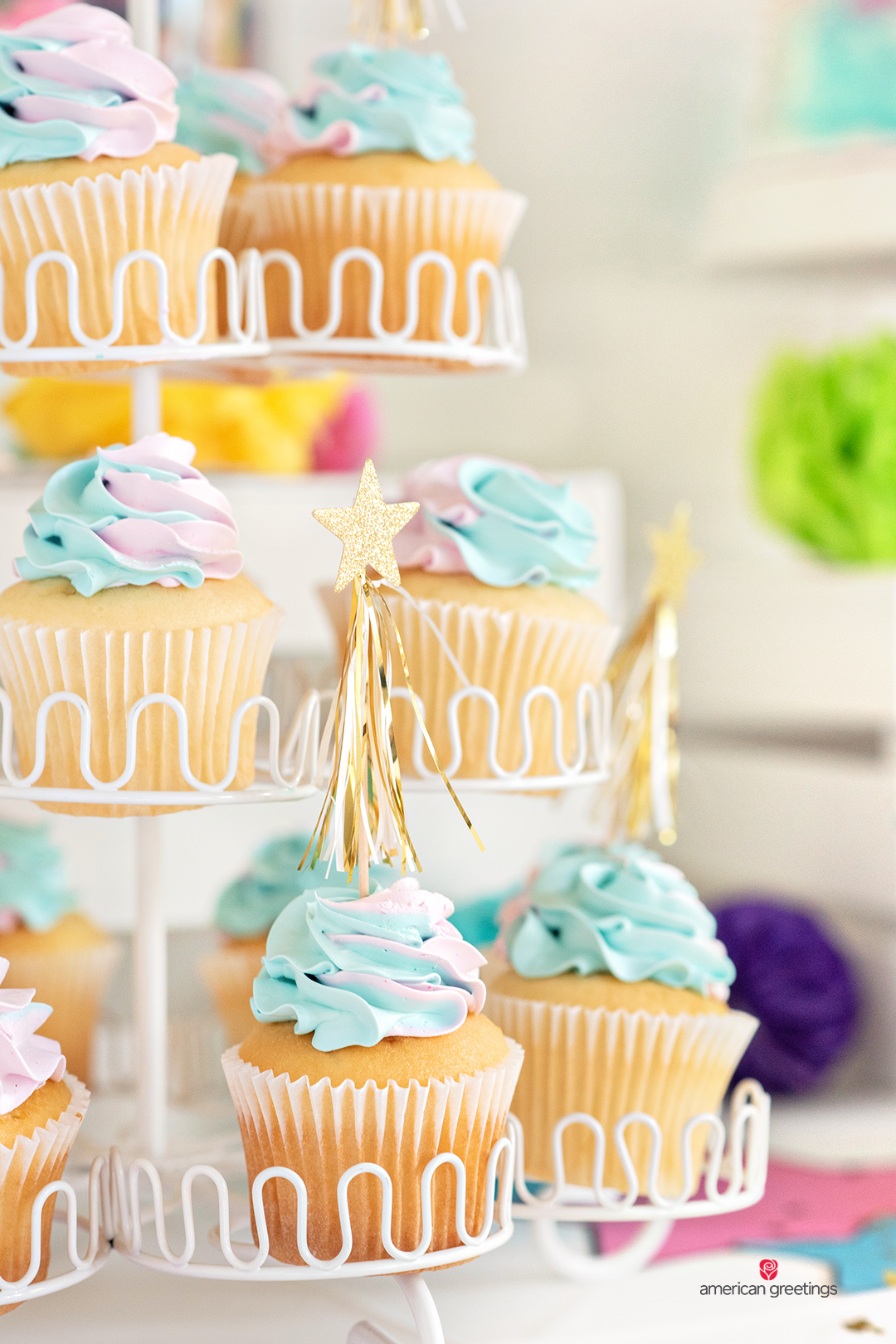 Cupcakes with colorful decoration on top of them.