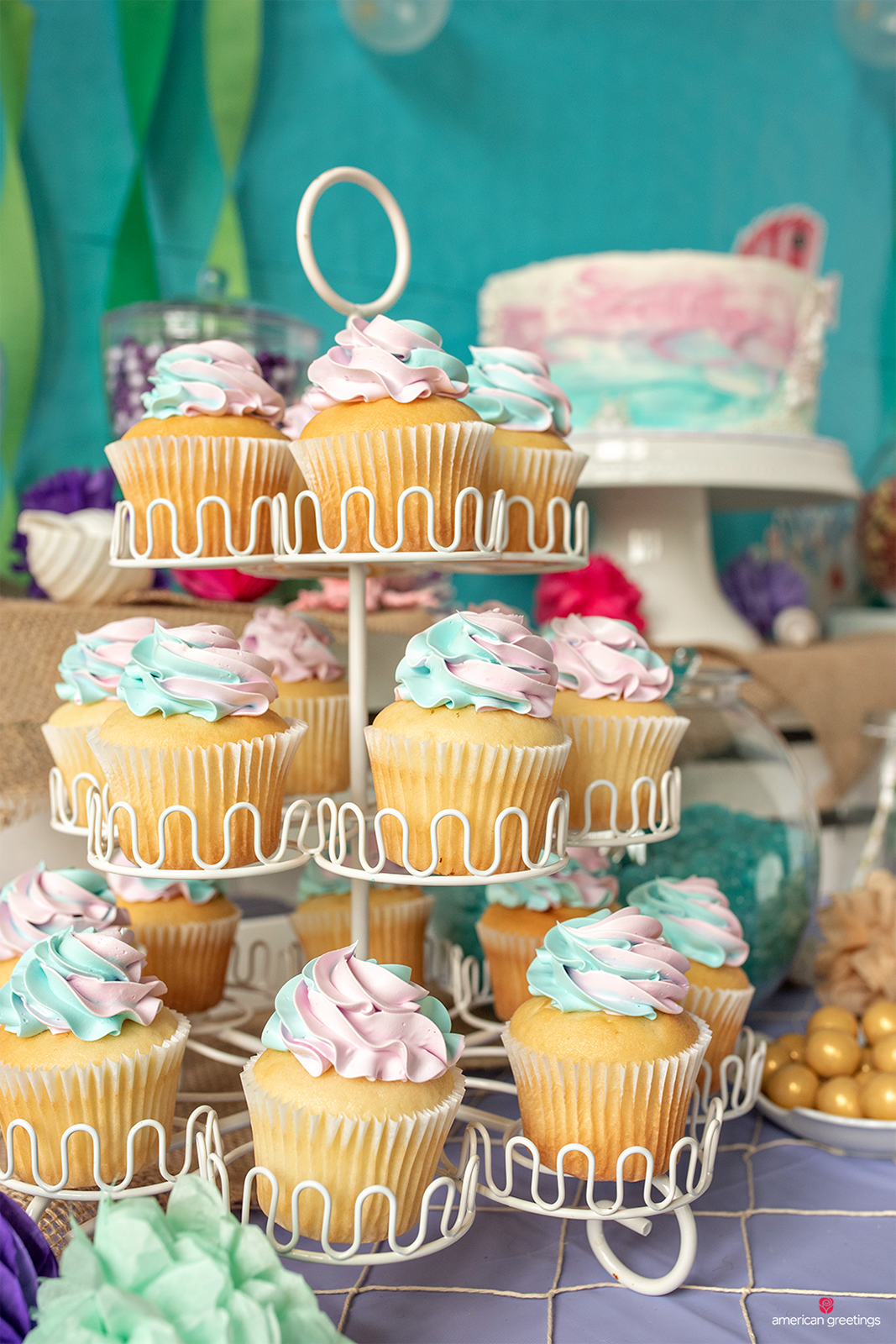 Cupcakes on a stand accessorized with pearl candies