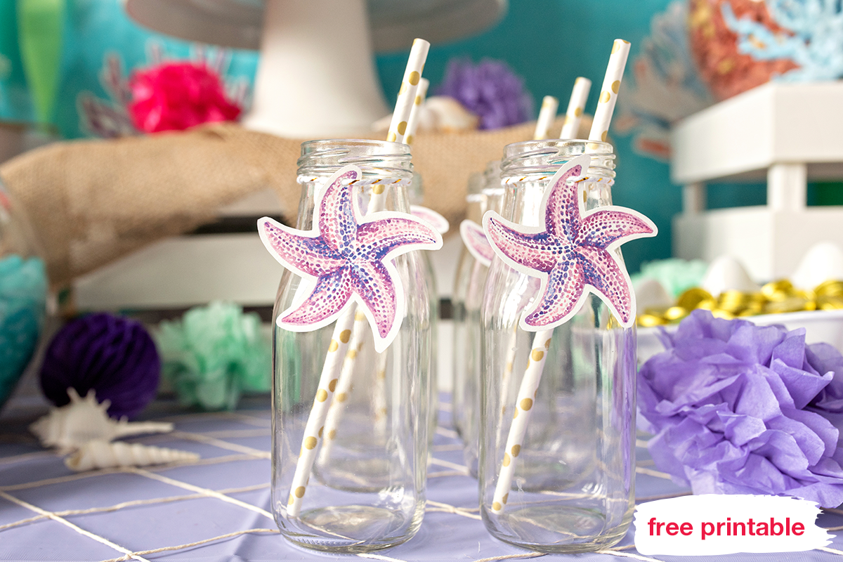 Milk bottles, with starfish printable, secured with gold baker's twine and color-coordinated straws