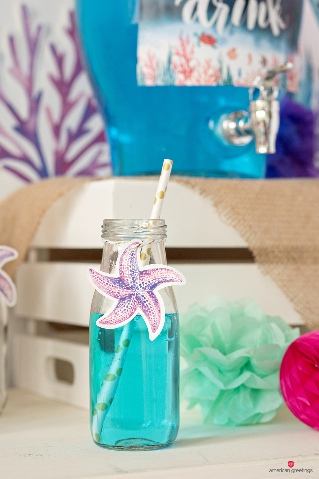 Milk bottles, with a starfish printable, secured with gold baker's twine and color-coordinated straws