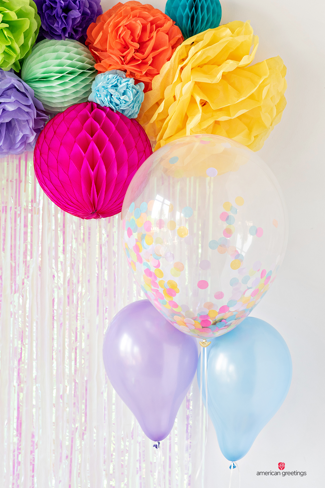 Confetti-balloons and tissue pappeer pom-poms and honeycombs in a variety of colors.