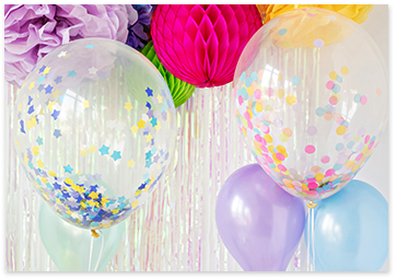 Oversized confetti-balloons and tissue papper pom-poms in a variety of colors.
