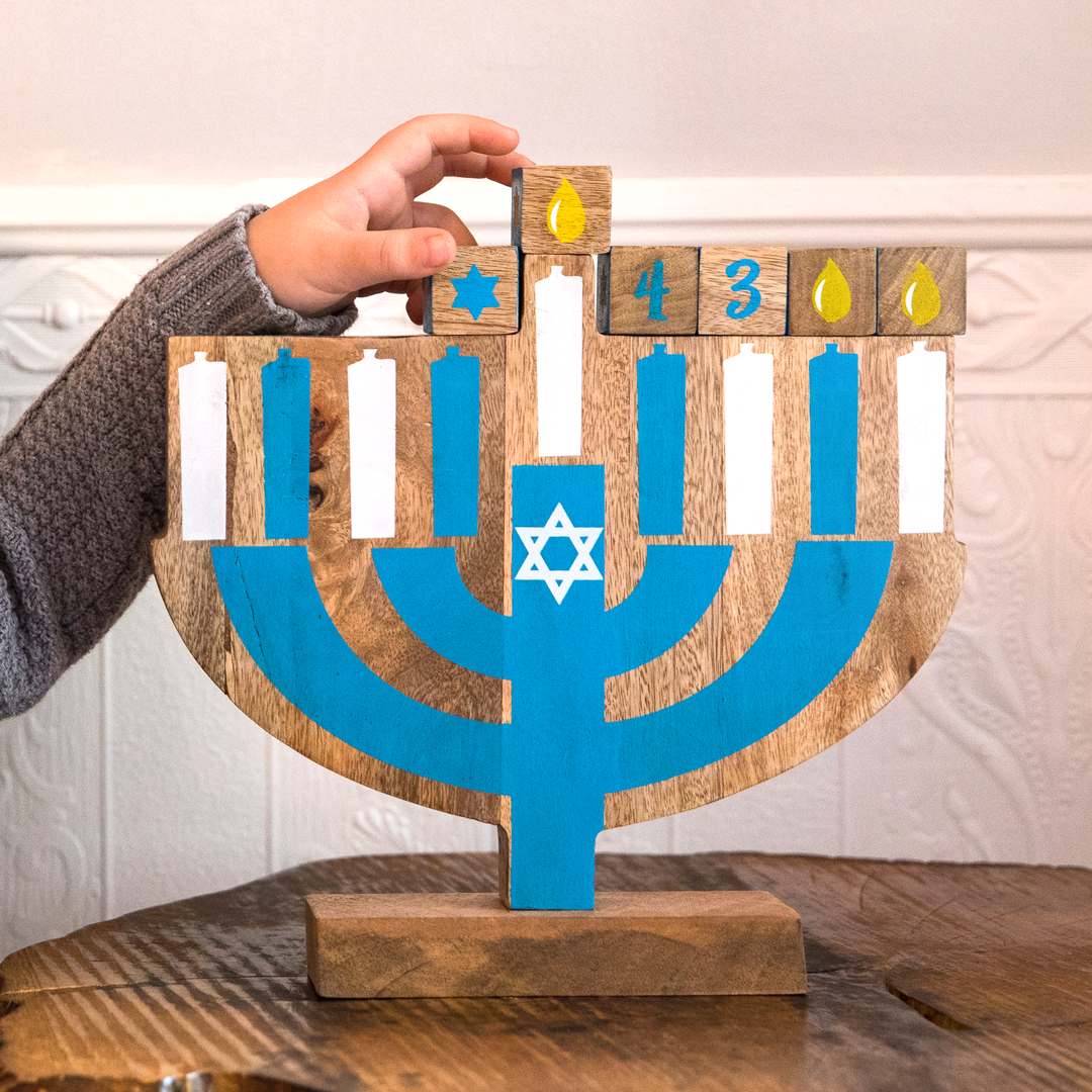 Wooden menorah serves as a gret introduction to Hanukkah tradition.