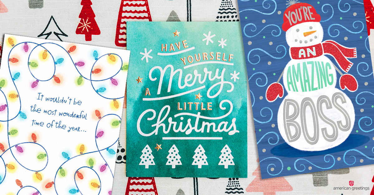 A collection of professional Christmas cards, next to christmas decorations
