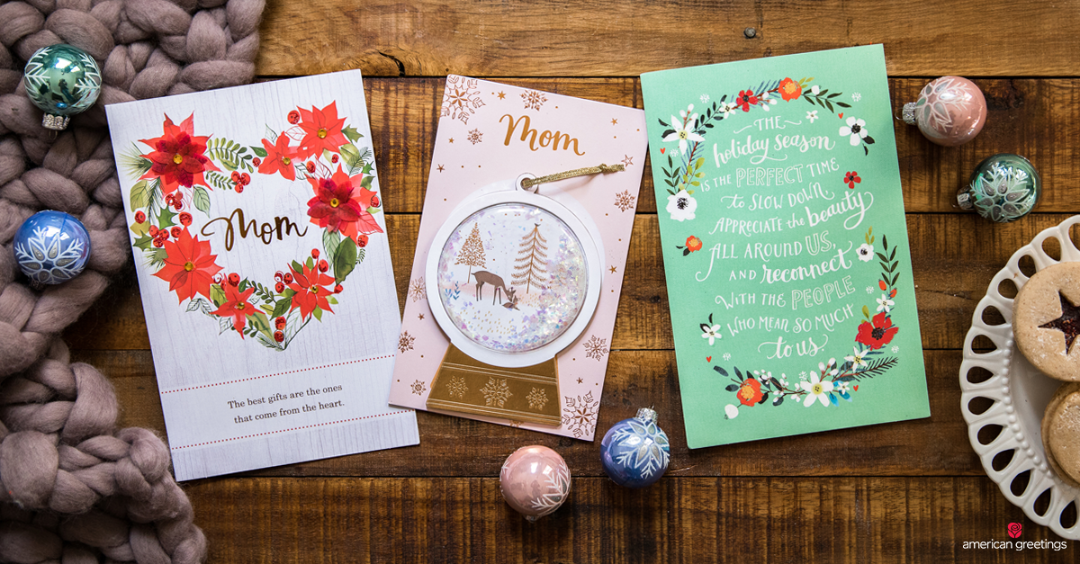 A collection of Christmas cards for moms, next to Christmas decorations