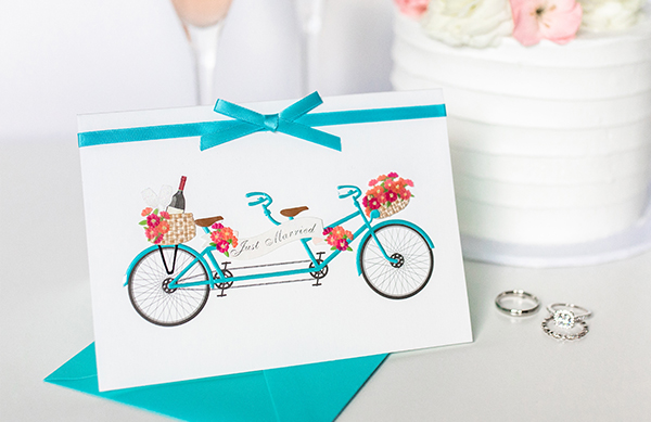Wedding greeting card with a Bike with a sign that reads just married