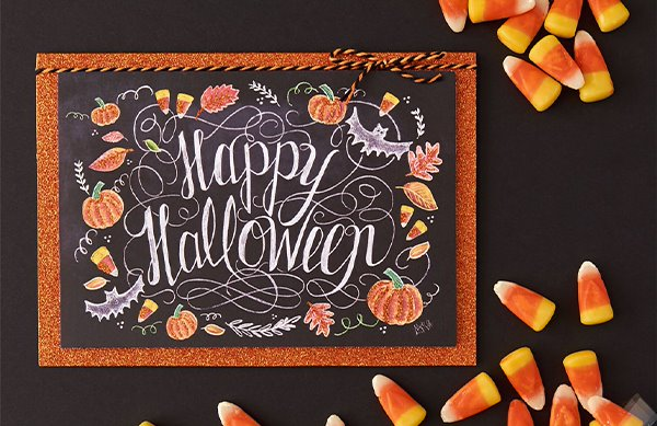 Happy Halloween Greeting Card Surrounded by Candy Corn